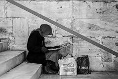 DSCF5514.jpg (㋡ Aziz) Tags: woman street xh1 56mm streetphotography city outside reading newspaper bw blackandwhite life old new stone metal grey contrast light