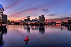 Salford Quays Sunrise (Marcin Frączek) Tags: sky reflection water city dusk cityscape evening afterglow skyline landmark river manchester sunset daytime morning metropolitanarea cloud urbanarea horizon mediacityuk architecture dawn waterway night sunrise sea salfordquays downtown uk salford redclouds colors
