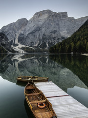 Row boats on Lago Di Braies, Italy, Dolomites (michael301187) Tags: canon eos 1635mm gitzo sunrise lagodibraies nationalpark italy dolomites ouutdoor holiday trees water tree green blue still mirror reflection natural nature europe landmark landscape national park fanessennesbraies valley valpusteria lake mountain boat pier jetty wooden row