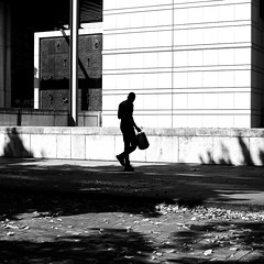 With the little bag (pascalcolin1) Tags: paris homme man mur wall lumière light ombre shade sac bag photoderue streetview urbanarte noiretblanc blackandwhite photopascalcolin 50mm canon50mm canon