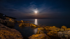 Mediterranean moon rising (Marco MCMLXXVI) Tags: cervo imperia liguria italy sea mare moon rising luna night nocturnal coast rocks longexposure outdoor landscape scenery sony rawtherapee ilporteghetto water scogli costa mood atmosphere europe nex5 serenity