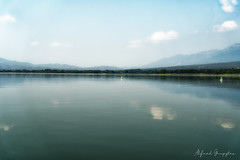 Hazy Day At Kerkini Lake (Alfred Grupstra) Tags: lake nature mountain water landscape scenics reflection sky outdoors mountainrange blue beautyinnature tranquilscene summer cloudsky forest nopeople tree greencolor hill 90 greece kerkinilake