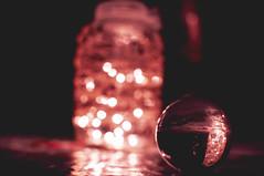 Desire / Vágy (NeSa.) Tags: glass selectivefocus crystalball illuminated lensball ball bokeh lights indoors