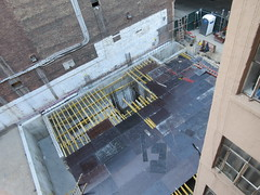Now Metal Plates - Building Construction Next Door 1531 (Brechtbug) Tags: parking lot space 350 352 now be building 2019 midtown manhattan 45th street near times square nyc 09172019 new york city cube architecture traffic transit car cars auto lots steel beams beam red brick wall green shed park brownstone 1920s apts apartment house apartments construction fence september