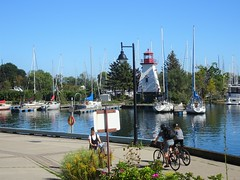 """Taking pictures is savoring life intensely, every hundredth of a second.""  – Marc Riboud (Trinimusic2008 -blessings) Tags: trinimusic2008 judymeikle nature toronto to ontario canada lake lakeontario water trees blueskies summer september sonydschx80 lighthouse candid cyclists pedestrian sailboats boats"