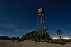 water tower. calipatria, ca. 2016. (eyetwist) Tags: eyetwistkevinballuff eyetwist watertower water abandoned farm agriculture calipatria saltonsea night desert dark nikon nikond7000 d7000 nikkor capturenx2 1024mmf3545g 1024mm fullmoon photography gel tripod npy nocturne longexposure derelict ruin decay california imperial sonorandesert salton sea startrails american west ca111 imperialvalley niland farming alfalfa tank tower old girder hardware truss steel landscape
