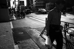 (ademilo) Tags: street streetphotography streetlight pedestrians pedestrian people pavement passer road roadside tokyo town townscape japan light lights city cityscape citylife contrast highcontrast