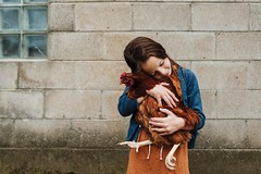 Always with the chicken snuggles:) (Elizabeth Sallee Bauer) Tags: family chicken childhood fun child farm country fresh eggs chicks farmanimals farmlife orange love girl kid happiness growth nurture homesteading playing rural outside outdoors tending raising rurallife warmcolors warmtones youth