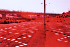 Being there, not being there (ale2000) Tags: 35mm fuji gela ql19 sicilia velvia analog analogue analoguefilm concrete corssprocess cxpro emptiness empty film parkinglot pellicola red road rosso xproed lomography xpro crossprocess crossprocessed canon filmisnotdead believeinfilm virato sicily countryside traveling trip lines linee geometry painted asfalto asphalt