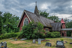 The Lady in Red...Cowichan Station's beautiful gem. (Picture-Perfect Pixels) Tags: standrewsanglicanchurch cowichanstation vancouverisland britishcolumbia historic architecture redwoodsiding scenic june2019 moody omniousclouds gravestones cemetary cemetery cedarshakes flickrexploreseptember182019