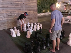 Chess Mates (Restless Eye) Tags: lasvegas nevada usa chess people couple giant outdoor match checkmate pawn king queen
