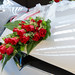 Decorated wedding car with flowers / red roses on the hood of Tesla Model X P90DL