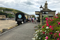West Bay (Jainbow) Tags: dorset westbay carriage train station flowers jainbow sausageandpear
