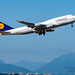 Panning A Rising Into the Blue Boeing 747-400 From YVR