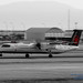 An Air Canada Express Q400 Landing at YVR in Black, White and Red
