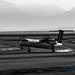 B&W of a Smoky Air Canada Q400 Landing