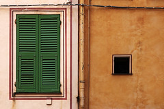 urban landscape - 77 (Rino Alessandrini) Tags: window wall facade urban contrasts colors plaster decaying dwelling city details lines shapes citizen abstract minimalist yellow ocher red green