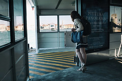Waiting for the ferry (Roberto Spagnoli) Tags: woman ferry sea color fotografiadistrada streetphotography venice venezia italy everydaylife wait