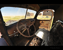 where it ends-up (Gordon Hunter) Tags: truck cab seat springs summer bright day steering wheel windshield country prairie rural abandoned decay patina rust brown farm ab canada gordon hunter nikon d5000