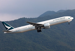 B-HNV Cathay Pacific B773 (twomphotos) Tags: plane aircraft spotting rwy25l departure vhhh hkg climbing out mountain backdrop evening light cathay pacific boeing b773