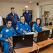 A new station crew practices rendezvous techniques on a laptop computer simulator