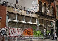 Graffiti.  Paste Up ( COST) . Lower Manhattan.   KAST. POE. KUETE. CELY. CINIK. ECOH. SEBI. CHINO. FAES. CENT. ANSR. AMOR. (Allan Ludwig) Tags: graffiti pasteupcost lowermanhattan kast poe kuete cely cinikecoh chino faes cent ansr amor