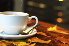 Hot, steaming cup of tea in cosy cafe in the Autumn (Martyn.Hayes) Tags: autumn autumncolours shallowdepthoffeild london october september november bokeh bokehballs orange red brown deadleafs leafs autumnleafs wood table cafe bar relaxing relax calm calming colours spoon cup cuppa tea hotdrink beverage steam