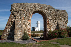 Framed lighthouse (wells117) Tags: archway lighthouse houses building seaside bush white doorway windows tall structure framed lawn hunstanton blue view grass sky stone tower old roof bricks arch wall oldhunstanton norfolk