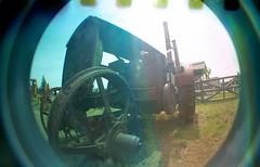 Photo Eye (Crusty Da Klown) Tags: kootenays fortsteele bc britishcolumbia canada tractor old lomo lomography fisheye lens camaera film kodak summer outside outdoors photo eye photoeye lofi circle round