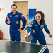 Expedition 61 crewmembers share a game of ping-pong