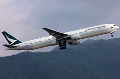 B-HNE Cathay Pacific B773 (twomphotos) Tags: plane aircraft spotting rwy25l departure vhhh hkg climbing out mountain backdrop evening light cathay pacific boeing b773