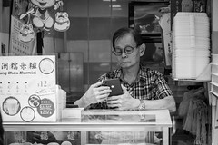 Everybody's mobile phone PTI (twomphotos) Tags: hong kong hongkong china city urban life skyscraper culture black white streetphotography people