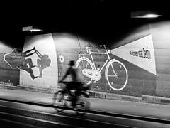 (empunkthapunkt) Tags: people bicycle tunnel underpass streetlife streetphotography streetart blackandwhite bw bwstreet monochrome mood atmosphere urban light wall menschen fahrrad strasenfotografie schwarzweiss schwarz licht weis einfarbig wand unterführung stadt olympus em10markii olympusm1442mmf3556iir grafitti