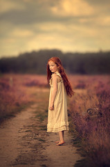 Looking Back ({jessica drossin}) Tags: jessicadrossin naturallight netherlands face portrait child girl redhair redhead heather road barefoot dress sky alone outdoors summer path wwwjessicadrossincom