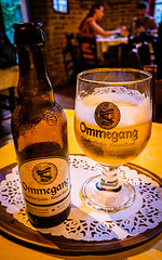 Glass of Ommegang Blond (8%) De-Garee Pub ( Bruges) (High ISO) (Ricoh GRIII 28mm APS-C Compact) (1 of 1) (markdbaynham) Tags: bruges brugge bruggen brugse brugsezot zot zotbruin architecture city citybreak cityscape citylife beer beerbottle label beerbottlelabel closeup lowlight highiso flemish flemishcity flanders westflanders building historic historiccity street stonework structure statue monument birra cerveza urban urbanlife europeancity metropolis medievalcity ricohgr ricohdigital ricohgriii ricohcompact ricoh grdiii grd3 grdigital 28mm f28 prime primelens fixedlens fixedlenscompact highendcompact degarre stamineedegarre pub drink church churchourlady bierpaleis bottle belgiumbeer belgiumcity