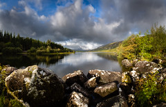 Llyn mymbyr (paullangton) Tags: llyn mymbyr wales snowndonia lake rocks sky clouds pano light landscape nature trees blue water