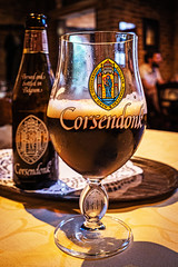 Glass of Corsendonk Bruin (6.5%) Staminee-De-Garre - Bruges (High ISO)  (Ricoh GRIII 28mm APS-C Compact) (1 of 1) (markdbaynham) Tags: bruges brugge bruggen brugse brugsezot zot zotbruin architecture city citybreak cityscape citylife beer beerbottle label beerbottlelabel closeup lowlight highiso flemish flemishcity flanders westflanders building historic historiccity street stonework structure statue monument birra cerveza urban urbanlife europeancity metropolis medievalcity ricohgr ricohdigital ricohgriii ricohcompact ricoh grdiii grd3 grdigital 28mm f28 prime primelens fixedlens fixedlenscompact highendcompact degarre stamineedegarre pub drink church churchourlady bierpaleis bottle belgiumbeer belgiumcity