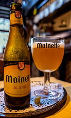 Bottle of Moinette Blond (De Garre Pub) (Bruges) (Ricoh GRIII 28mm APS-C Compact) (1 of 1) (markdbaynham) Tags: bruges brugge bruggen brugse brugsezot zot zotbruin architecture city citybreak cityscape citylife beer beerbottle label beerbottlelabel closeup lowlight highiso flemish flemishcity flanders westflanders building historic historiccity street stonework structure statue monument birra cerveza urban urbanlife europeancity metropolis medievalcity ricohgr ricohdigital ricohgriii ricohcompact ricoh grdiii grd3 grdigital 28mm f28 prime primelens fixedlens fixedlenscompact highendcompact degarre stamineedegarre pub drink church churchourlady bierpaleis bottle belgiumbeer belgiumcity