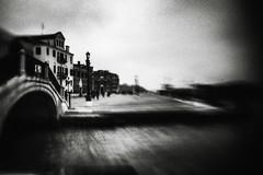 3451 (Elke Kulhawy) Tags: venice venedig italien italy monochrome monochromes lensbaby lensbabycomposer landschaft landscape stadt surreal schwarzweiss sky wasser water wolken blackandwhite bnw bw bnwbw bwphotographie bridge black venezia grain grainy art abstract architektur kunst kontrast verschwommen vignette gondola