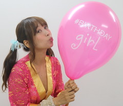 Should She Really Kiss It? (emotiroi auranaut) Tags: attractive gorgeous beautiful beauty bulging woman lady girl birthday kimono pretty lovely ponytails kiss kissing toy balloon big full pink tease teasing