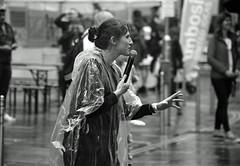Keep Calm and Carry On, It's Only Rain (IMG_0001mod) (AngusInShetland) Tags: glasgow rain vivitar28200f3553zoom scotland merchantcity streetperformance streettheatre minolta dynax7000i maxxum ilford xp2400super xp2 analogue film 35mm people outdoors street portrait city festival canoscan5600f