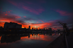 skies from puerto madero (viewsfromthe519) Tags: buenosaires argentina sunset sky skyscape cloudscape evening city ciudad autonoma caba red orange pink blue magenta clouds puertomadero puentedemujer bridge ship river reflection