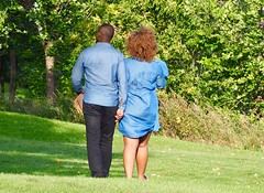 The Couple in Blue - (Irene, Montreal, QC) Tags: thecoupleinblue couple people allpeople friends blue blueoutfits blueclothing fashions grass greenery greenleaves shrubs shrubbery trees treesilhouettes treebranches park parkscenes