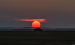 Ball of Fire (Christy Turner Photography) Tags: sun fire ball sunset prairies canada barn