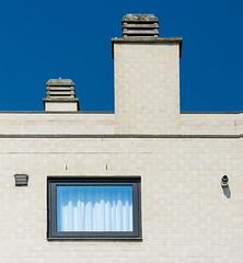 Two chimneys (jefvandenhoute) Tags: belgium belgië leuven light shapes geometric wall window