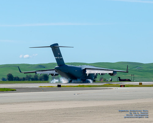 A C-17 MAKING A SMOKING TOUCH ON TRAVIS AFB RUNWAY
