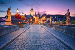 Wurzburg. (Rudi1976) Tags: wurzburg oldmainbridge germany bavaria riverside riverbank urban outdoors europe oldtown cityscape city town 2019 traveldestinations architecture tourism building citylife dawn twilight illuminated blue landmark famousplace vibrant bright morning sky skyline riverfront bridge sculpture clouds nopeople sunrise exterior summer clocktower road square cathedral european church streetlamp street