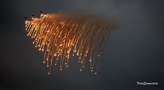 Swiss Patrol flares at Hecthel Sanicole 2019  - Sunset Airshow  2019-09-13 19-17-20  - G55A4961 - mod et signe (vincent.lempereur) Tags: swissf5tigerii patrouilleaccrobatique airshow air meetingaérien sanicoleairshow sunsetairshowsanicole plane patrouillesuisse fighter militaryaircraft militaryaviation military