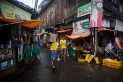 yellow lovers - Kolkata (Karthikeyan.Chinnathamby) Tags: karthikeyan chinnathamby chinna canon canon5d canon5dmarkiii candid street streetlife streetphotography streets streelife streetaction walk kolkata india westbengal corner yellow cwc chennaiweekendclickers cwc742 scene streetscene rain rainyday monsoon