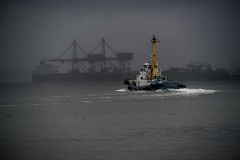 Tugboat with rain (sKamerameha) Tags: rain tugboat ship boat strait sea storm gray
